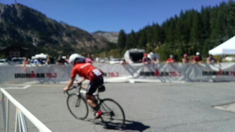 Blurry shot of me on the bike. It was a long day out there and I was happy to be rounding into transition.