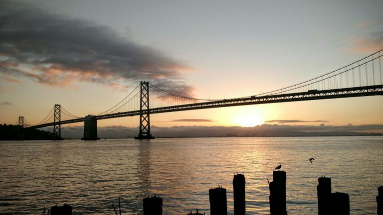 Gosh, this sunrise-under-the-bridge view never gets old.