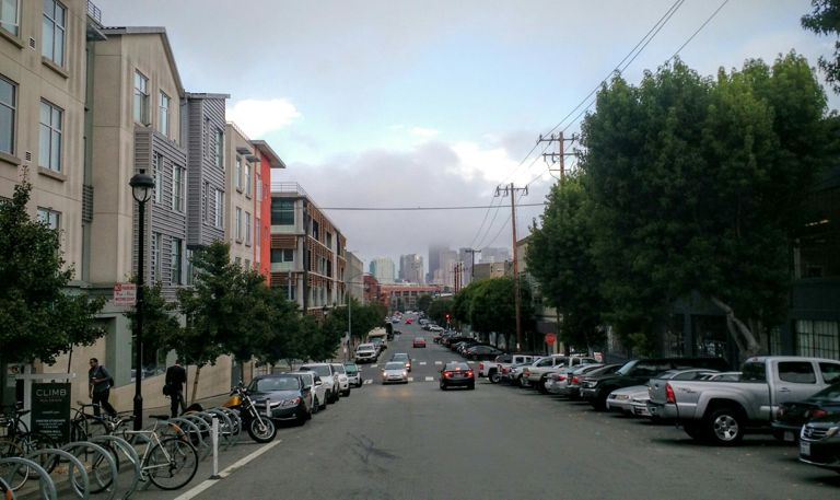 Some fog obscures the tops of the buildings in downtown San Francisco.